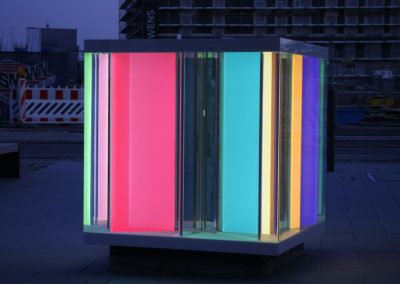 Illuminated LightCube in front of Kindergarten evening dusk