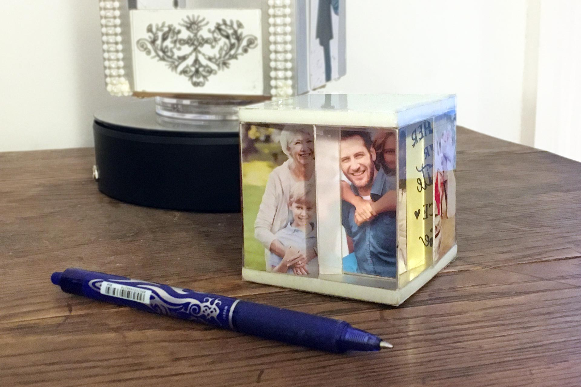 FunCube with personal family photographs set on a table